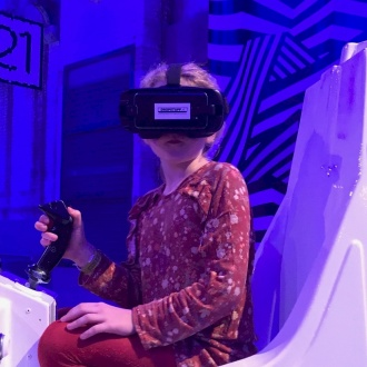Learner with VR headgear